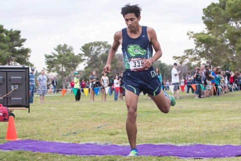 Omar Rubio, from Green Valley High School, finishes first during the Regional 4A Sunrise Boy ...
