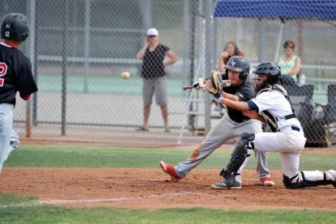 Shadow Ridge catcher Robbie Galvan steps forward to grab the ball as Las Vegas' Kyle C ...