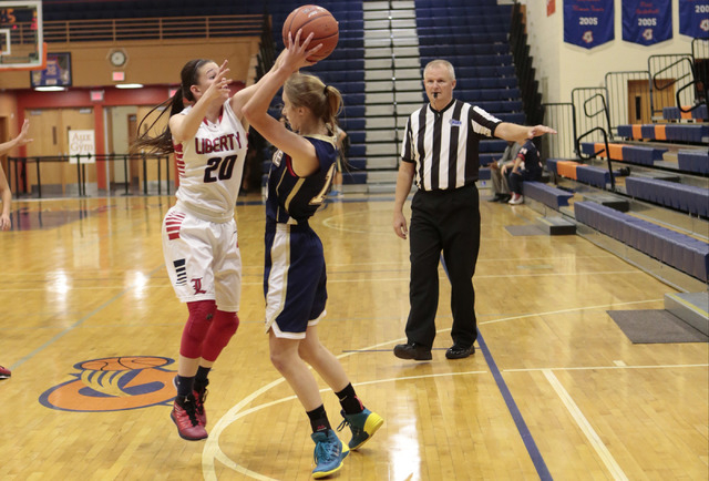 Liberty's Kealy Brown (20) defends Skyline's Hannah Anderl (15) during the secon ...