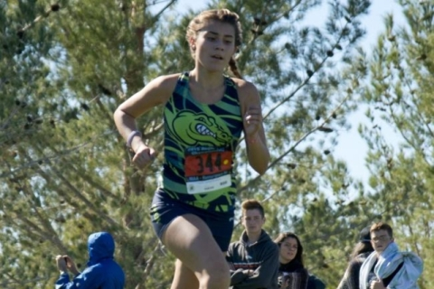 Mia Smith of Green Valley High School finishes first during the girls Division I Sunrise cro ...