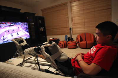 With his leg in a rehabilitation machine designed to increase range of movement, Lake Mead C ...