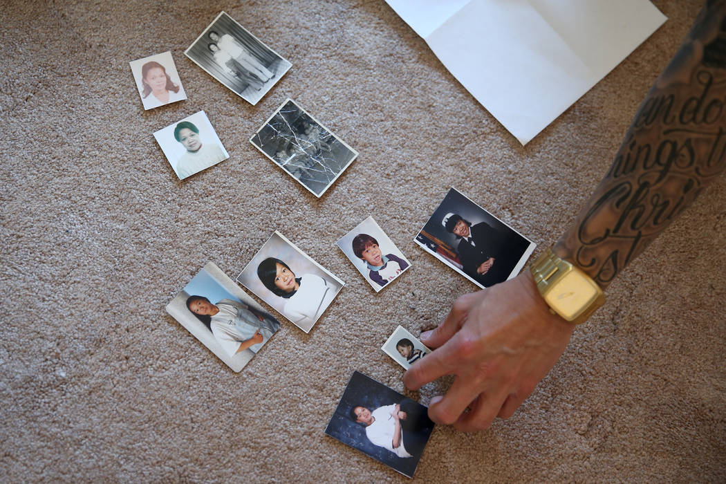 Jerome Penaranda shows pictures of his family at his Las Vegas home, Thursday, March 7, 2019. ( ...