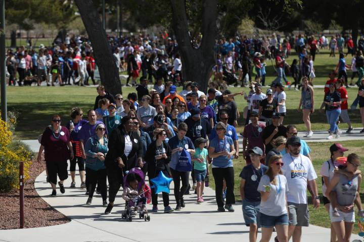 People participate during the Out of the Darkness Suicide Prevention Walk at Craig Ranch Park i ...