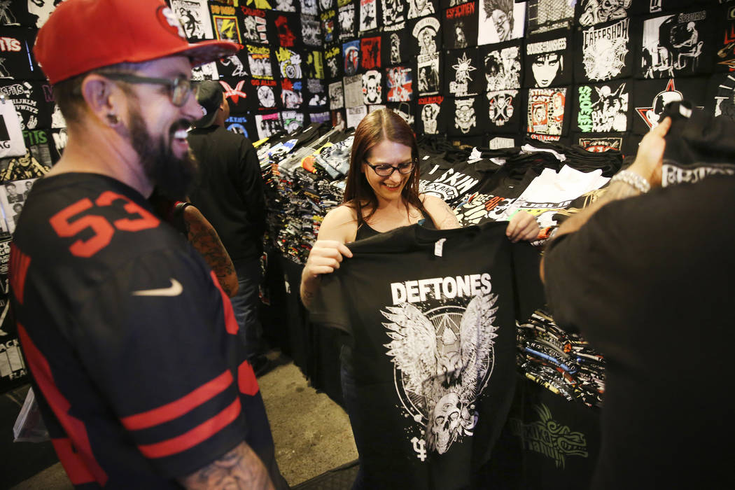 Customer Michelle Foulks, center, of Salt Lake City, Utah, shops for a shirt at the Latino's Ro ...