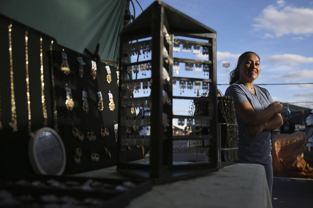 Vendor Rosario Malvaez stands in front her her jewelry booth at the Broadacres Marketplace in N ...