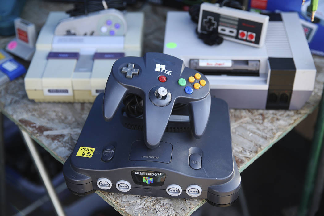 Classic gaming consoles are seen at the Alexis Video Games booth at the Broadacres Marketplace ...