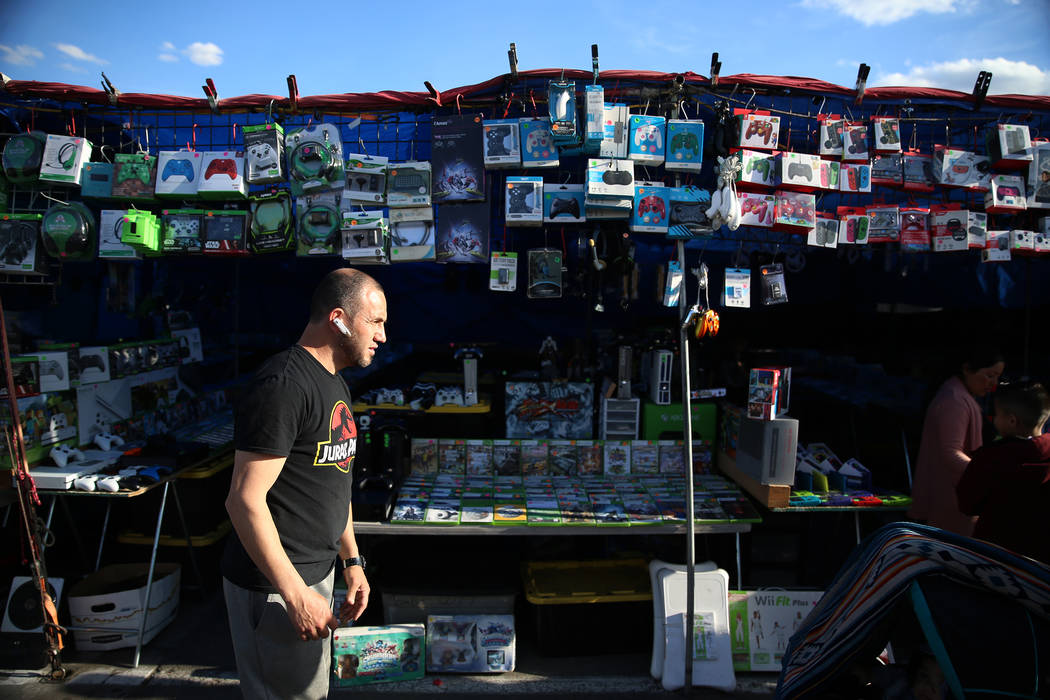 Carlos Figueroa, owner of Alexis Video Games, stands in front of his booth at the Broadacres Ma ...