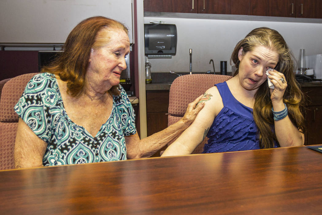 Joan Miller, left, the longest-tenured volunteer with the Trauma Intervention Program, consoles ...