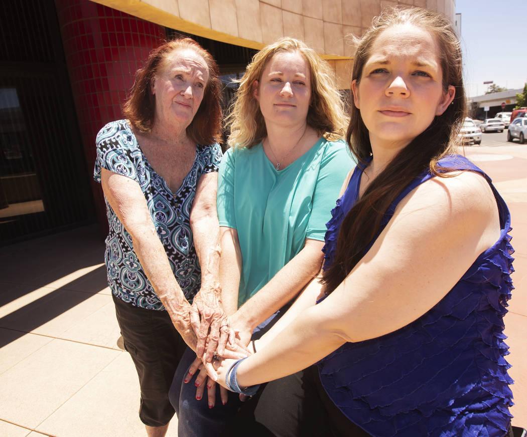 Joan Miller, 77, Jill Roberts, 43, and Lori Ann Waddell, 40, takes a portrait outside of the La ...