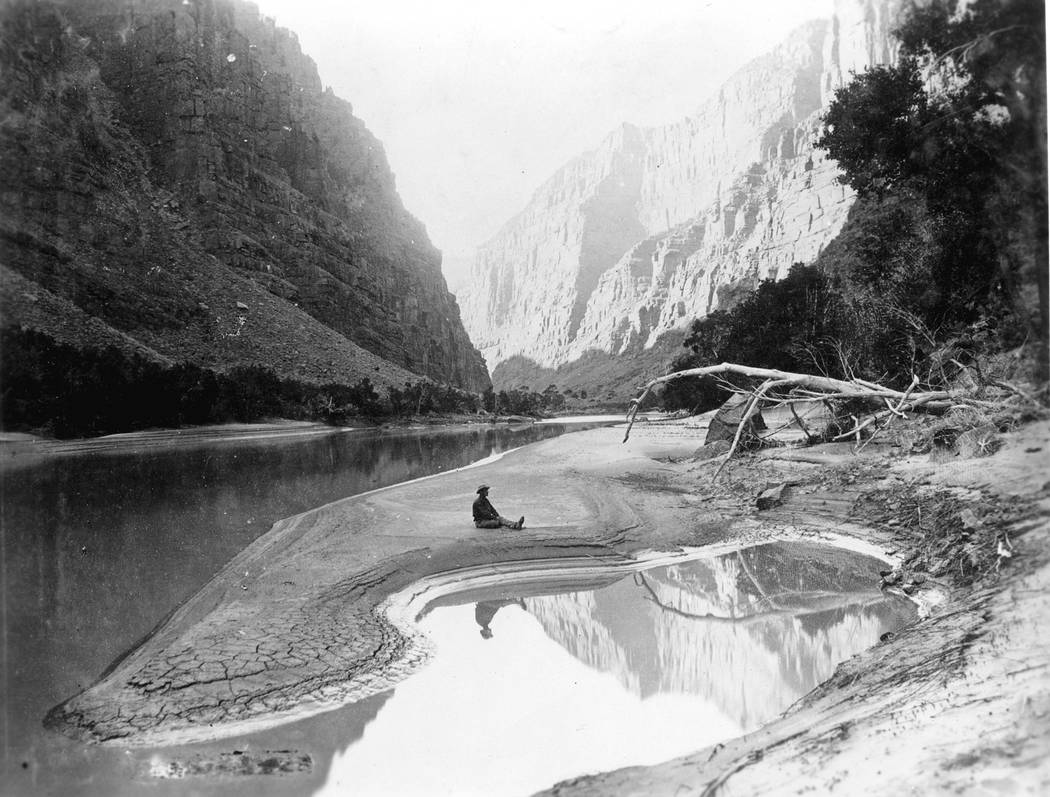 2ND POWELL EXPEDITION. DELLENBAUGH SEATED & REFLECTED IN GREEN RIVER. LADORE CANYON. GRCA 1 ...