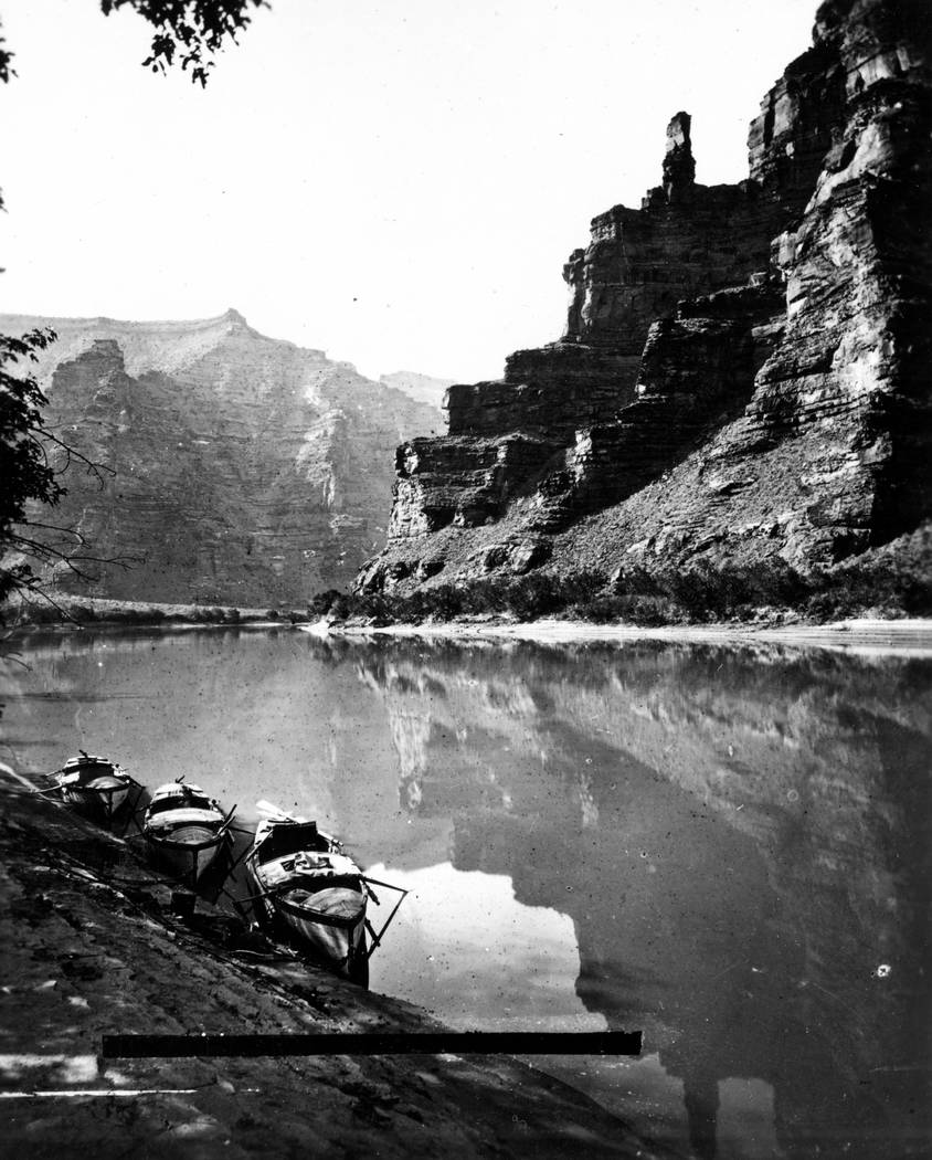 Lighthouse Rock in Canyon of Desolation, Green River. The three boats are anchored near shore o ...