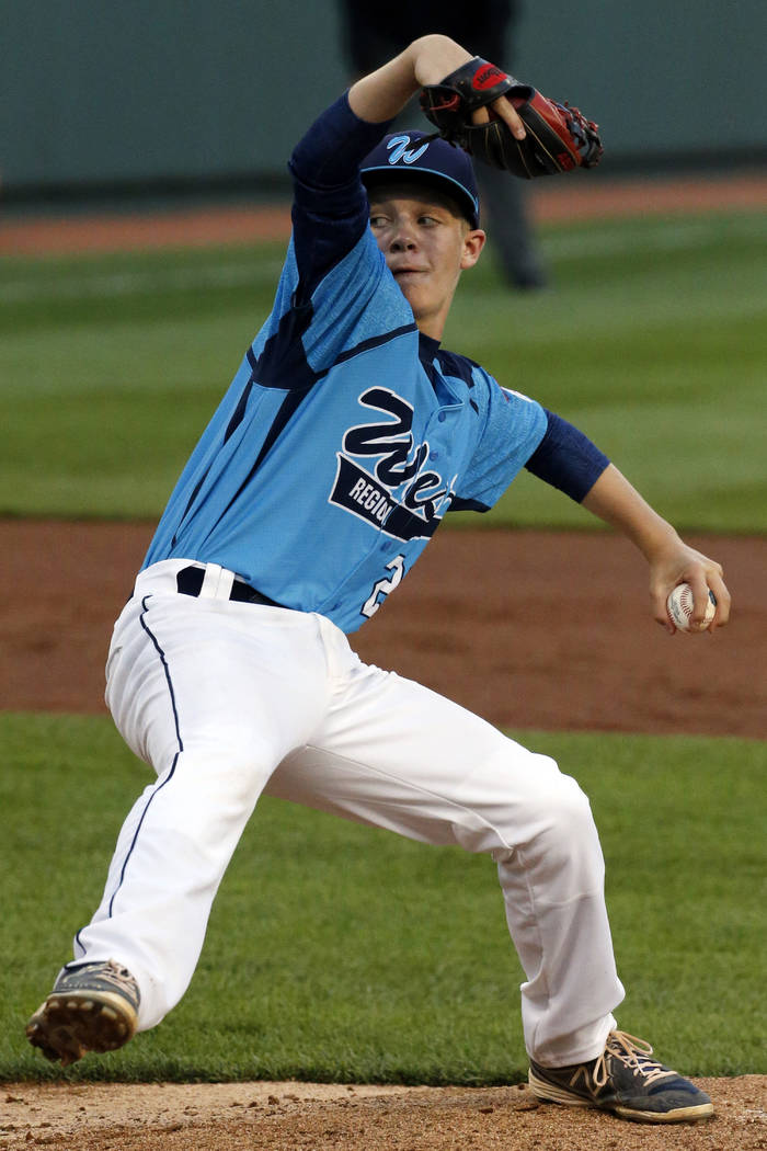 Mountain Ridge pitcher Austin Kryszczuk delivers during a baseball game against Rapid City, Sou ...