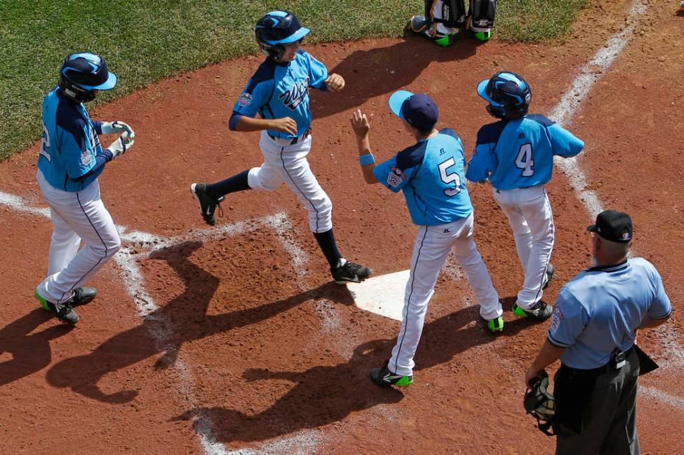 Las Vegas' Dominic Clayton, second from left, celebrates with after hitting a two-run home run ...