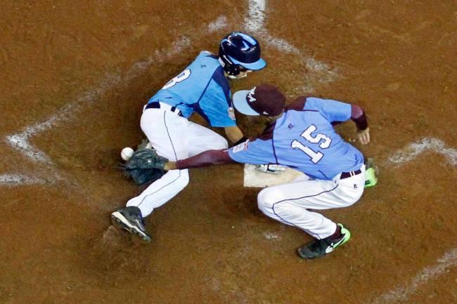 Las Vegas' Dallan Cave (8) scores on a wild pitch by Philadelphia pitcher Kai Cummings (15) in ...
