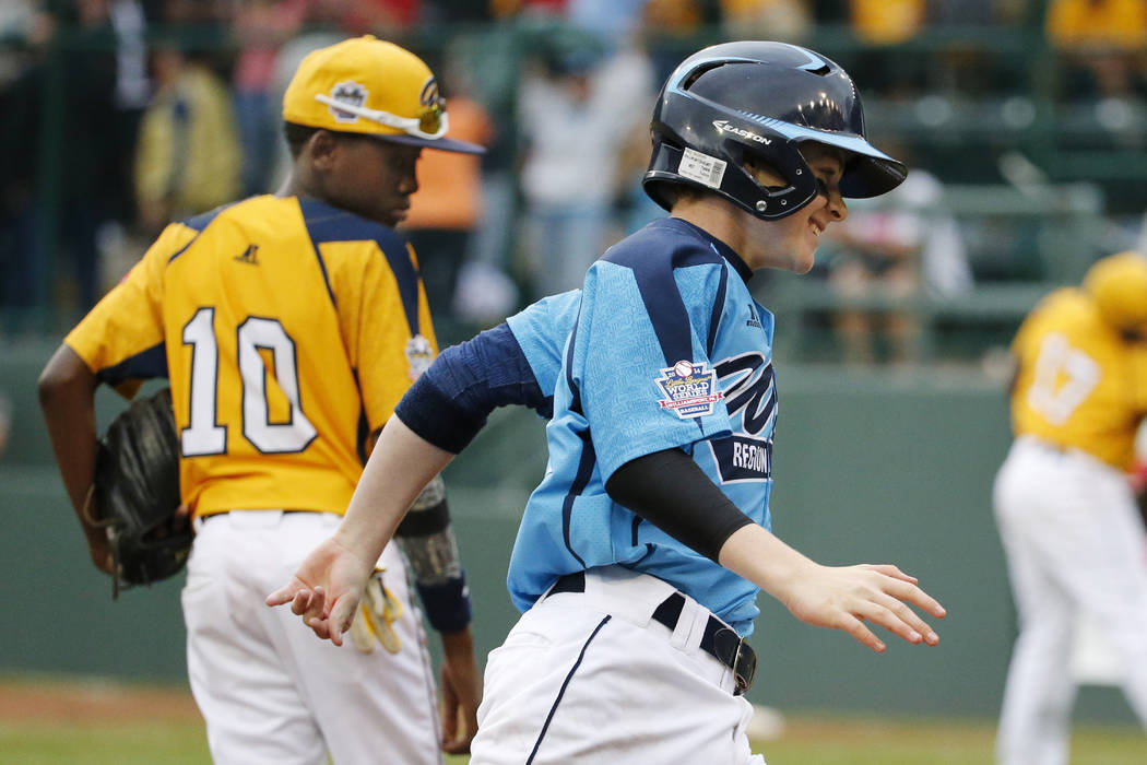 Las Vegas' Brad Stone rounds third past Chicago's Cameron Bufford (10) after hitting a two-run ...