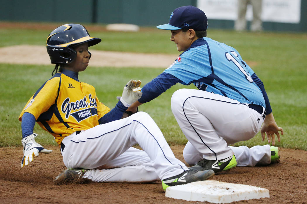 Chicago's Jaheim Benton, left, slides safely into third ahead of the tag by Las Vegas' Dillon J ...