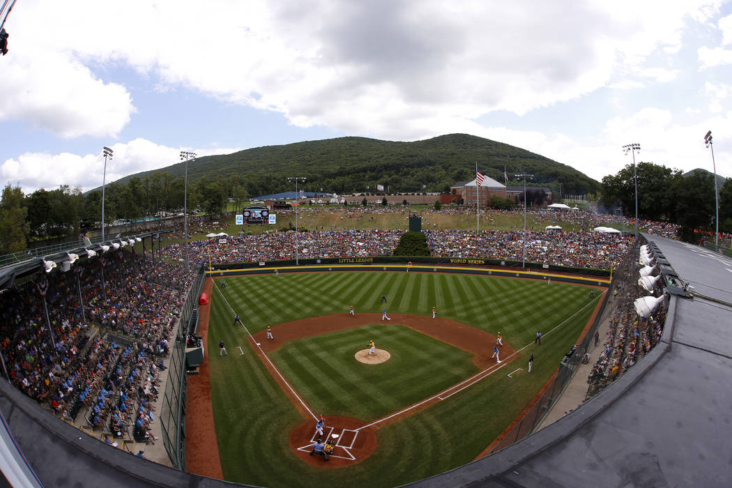 In this photo taken with a fisheye lens Lamade Stadium is filled to capacity to watch a basebal ...