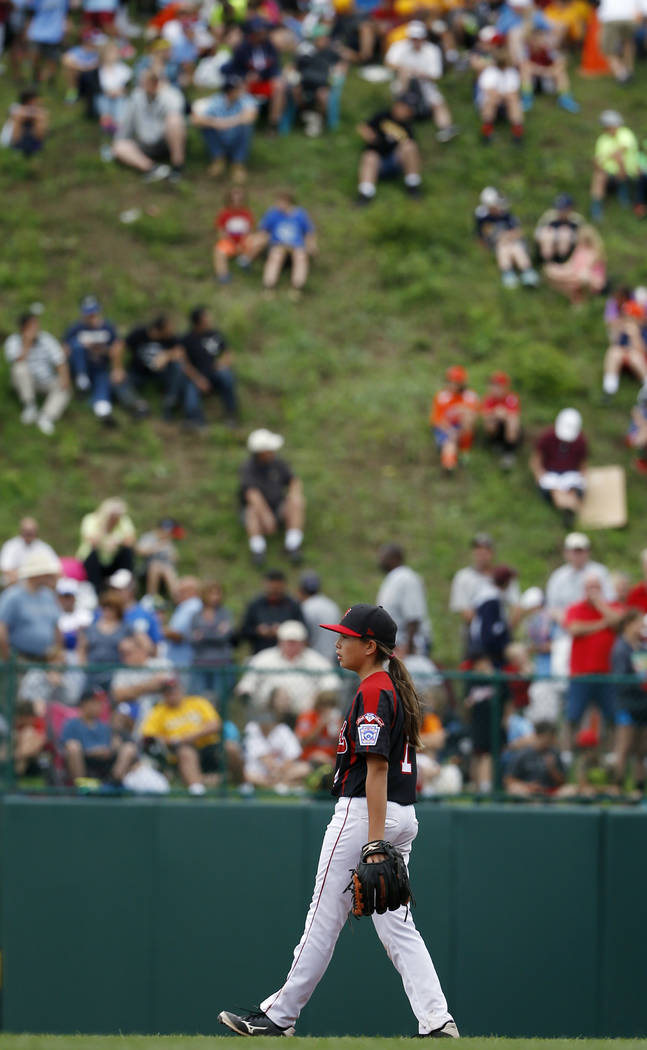Canadas Emma March paces at her position during the second inning of an international pool play ...