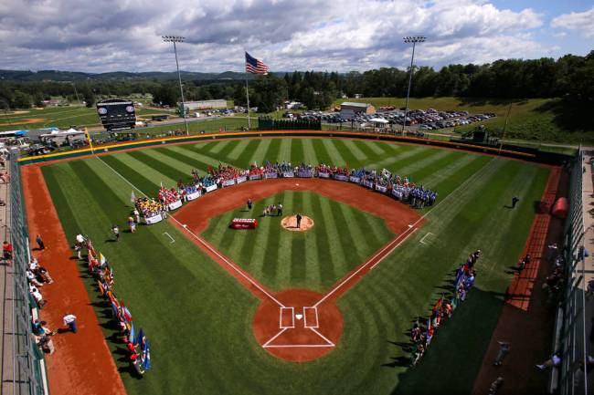 The 16 Little League baseball teams from around the world line the field at Volunteer Stadium d ...