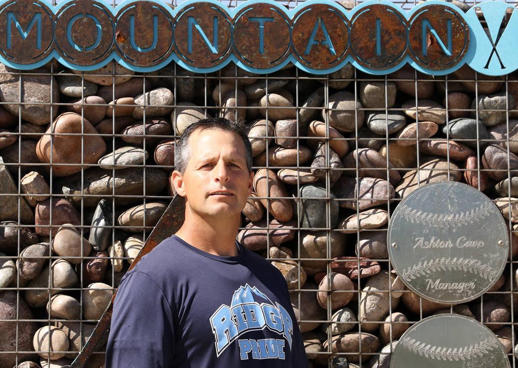 Ashton Cave, who managed the Mountain Ridge team during the 2014 Little League World Series, po ...