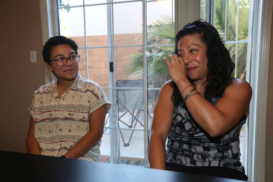 Percy Neavez watches as his mother, Brenda, cries while discussing her son's transition at thei ...