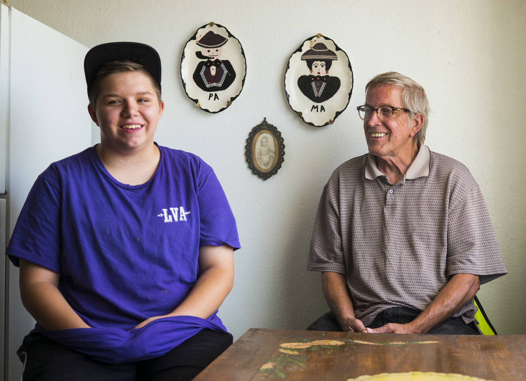 Fifteen-year-old Ryan Lauer, left, with his father, Jack Lauer, at their home near downtown Las ...