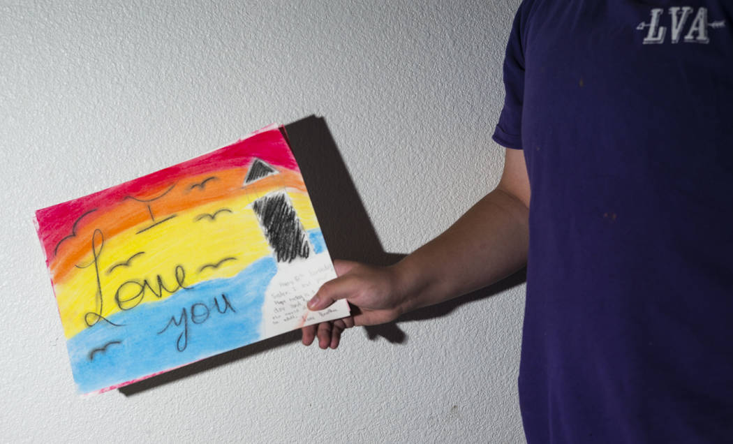 Fifteen-year-old Ryan Lauer shows artwork he made for his sister at home near downtown Las Vega ...