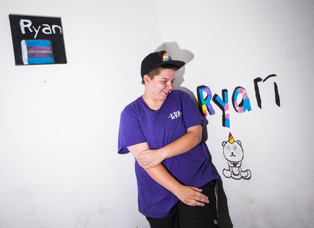 Fifteen-year-old Ryan Lauer poses with artwork at home near downtown Las Vegas on July 18, 2019 ...