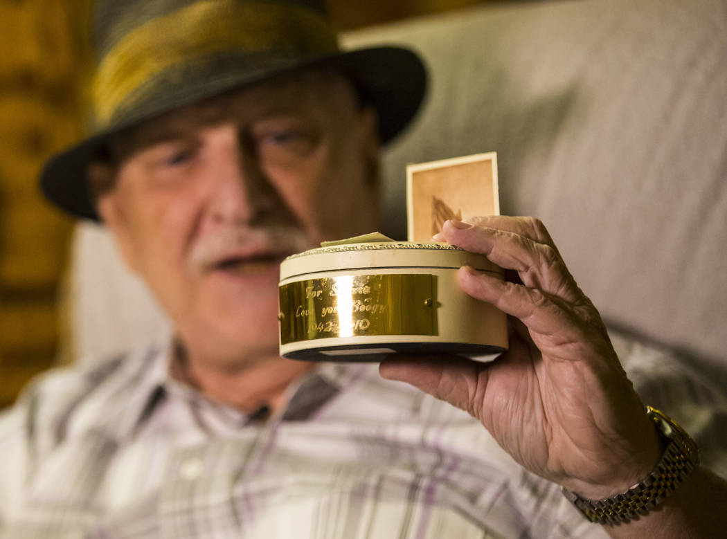 """Jerry Kaczmarek holds a container with the partial remains of longtime friend Charles """"Boo ..."""