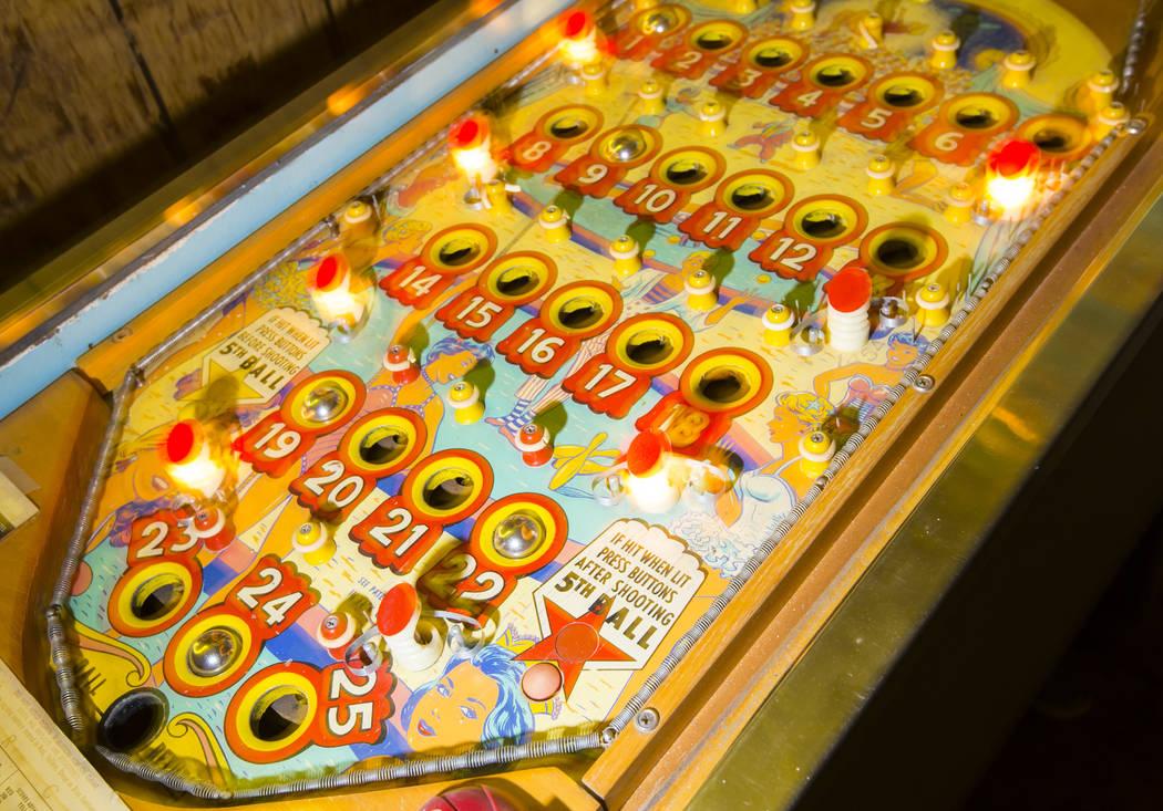 "Jerry Kaczmarek plays on the ""Circus Queen"" bingo pinball machine at his home in Bull ..."