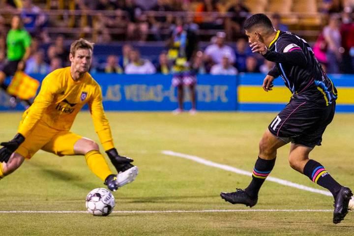 Las Vegas Lights FC forward Irvin Parra (11, right) sends a shot towards the net past Orange Co ...