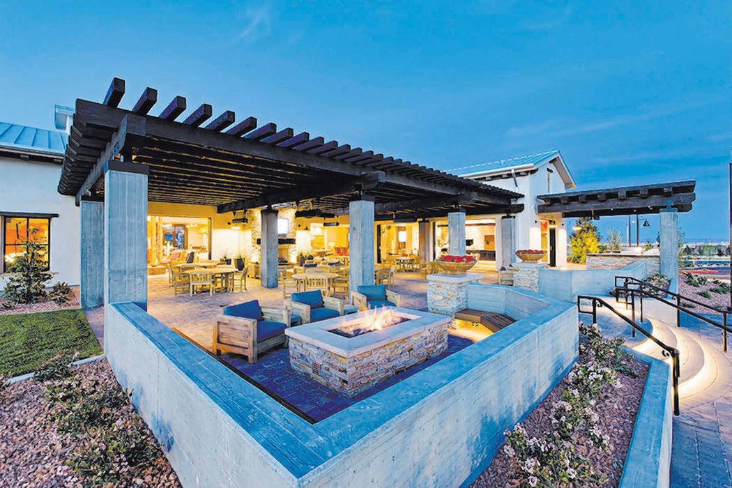 Skye Center, the community's social hub, features an open-air bistro and indoor/outdoor firep ...