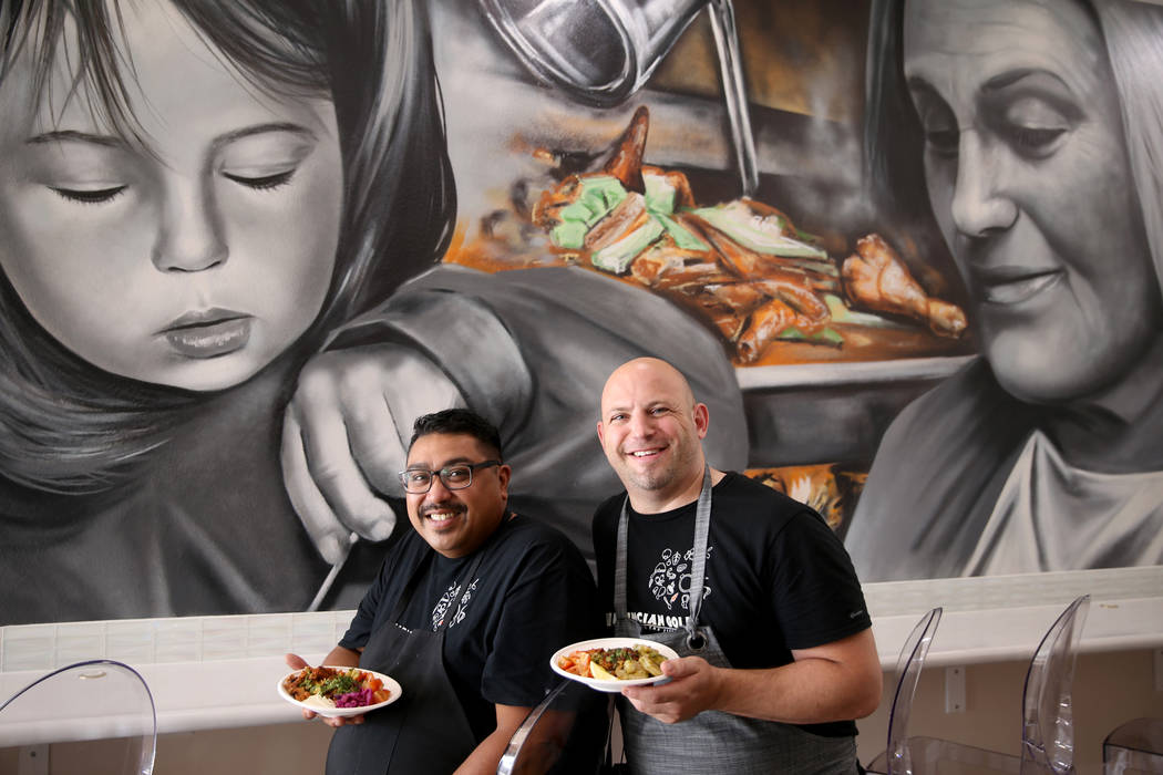 Paras Shah, left, and Jeffrey Weiss, both chefs and co-owners, at Valencian Gold in Las Vegas T ...