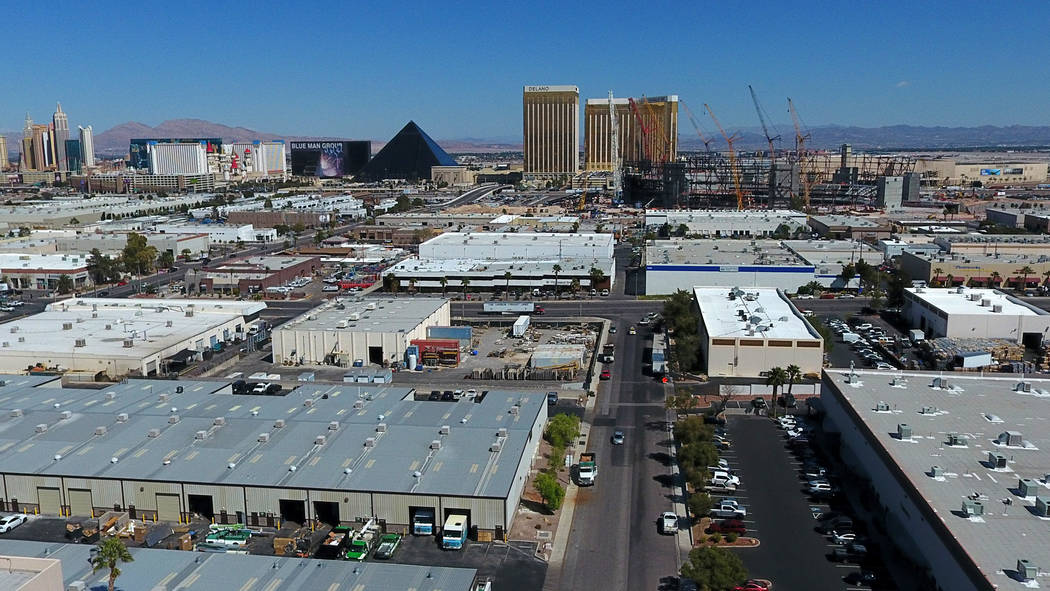 Aerial view of Raiders stadium, center, in Las Vegas as it continues to take shape between a la ...