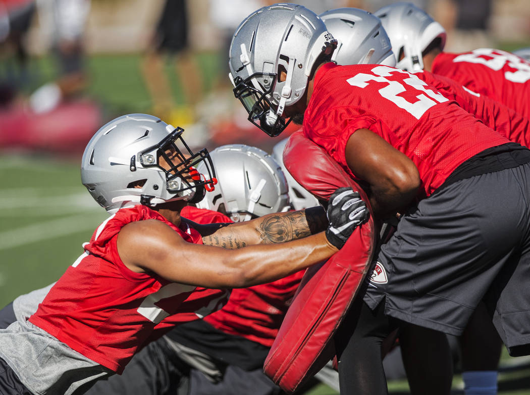 UNLV defensive back Demitrious Gibbs (22) works through a drill with defensive back Bryce Jacks ...