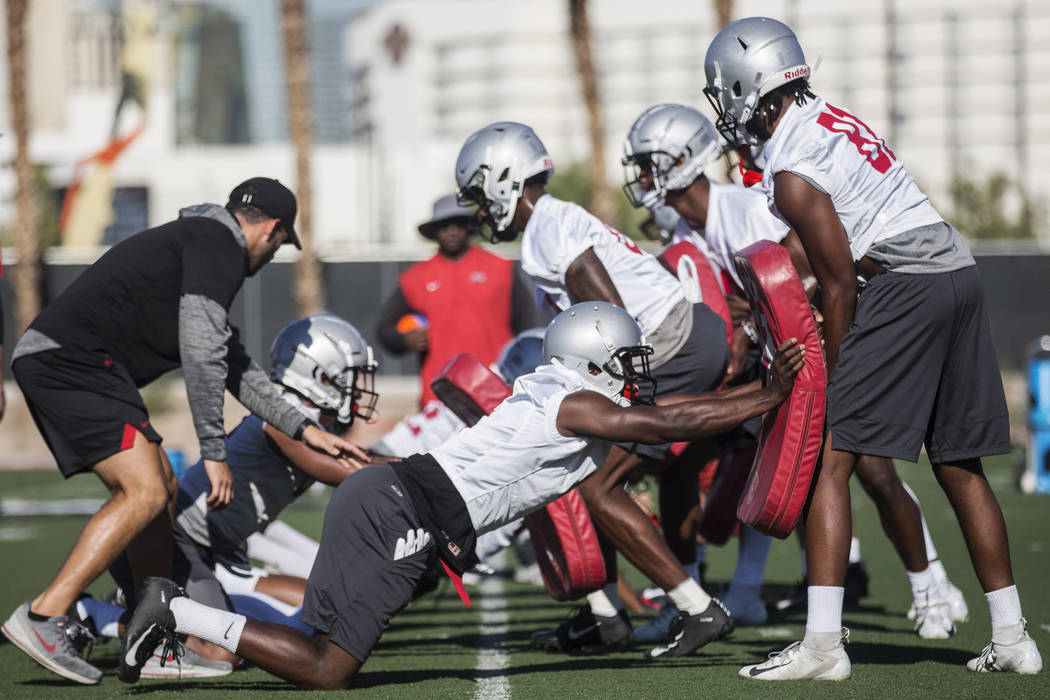 UNLV wide receiver Andre Collins Jr., right, works through a drill with Mekhi Stevenson during ...