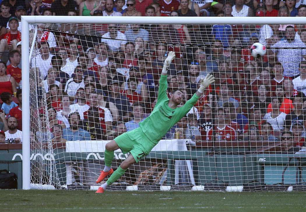 Liverpool goalie Andy Longergan is unable to make the save on a goal by Sevilla's Aguido Duran ...