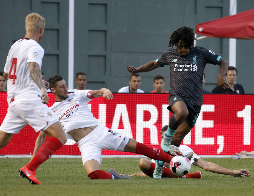 Liverpool's Yasser Larouci powers through a slide from Sevilla's Escudero during the second hal ...