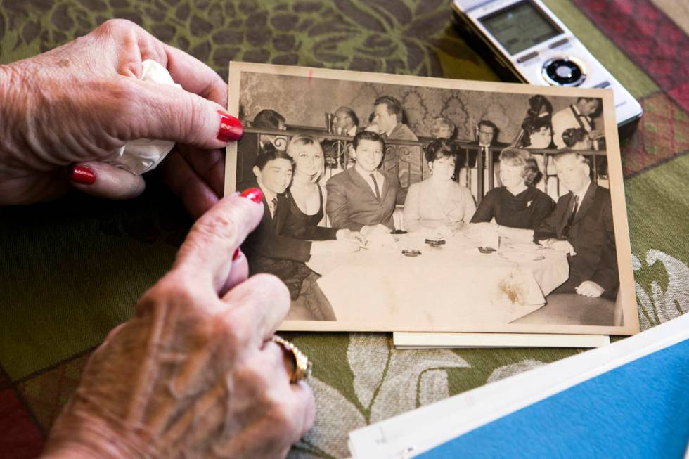 Peggy DiMaria look at an old family photo of her brother, Jay Sebring, when he was visiting the ...