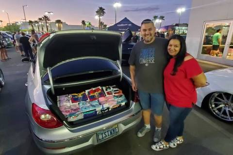 Miguel and Stephanie Landrove made a large donation of pajamas at Findlay Volkswagen in the Val ...