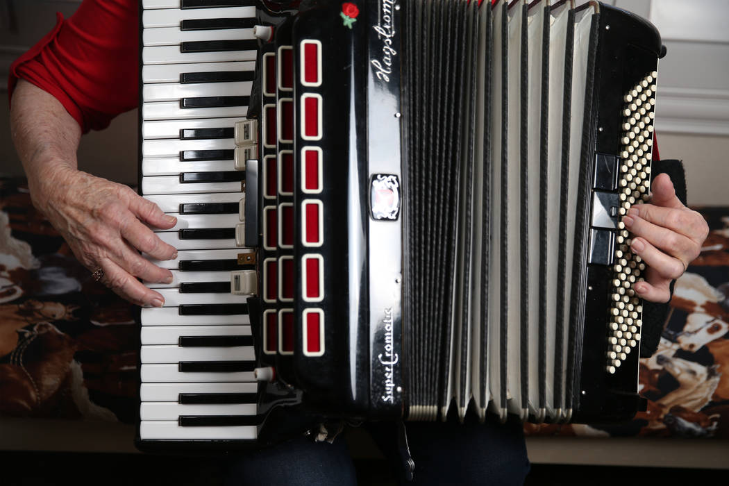 Etta Baykara, 91, plays accordion at her home in Las Vegas, Tuesday, July 30, 2019. Baykara wro ...