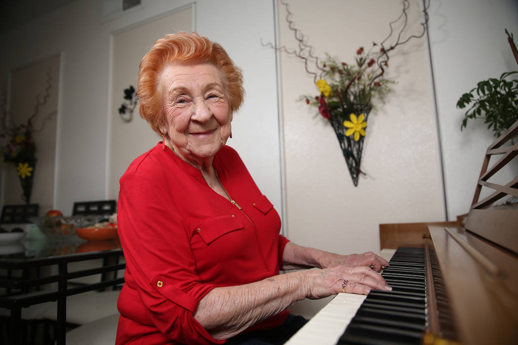 Etta Baykara, 91, plays the piano at her home in Las Vegas, Tuesday, July 30, 2019. Baykara wro ...