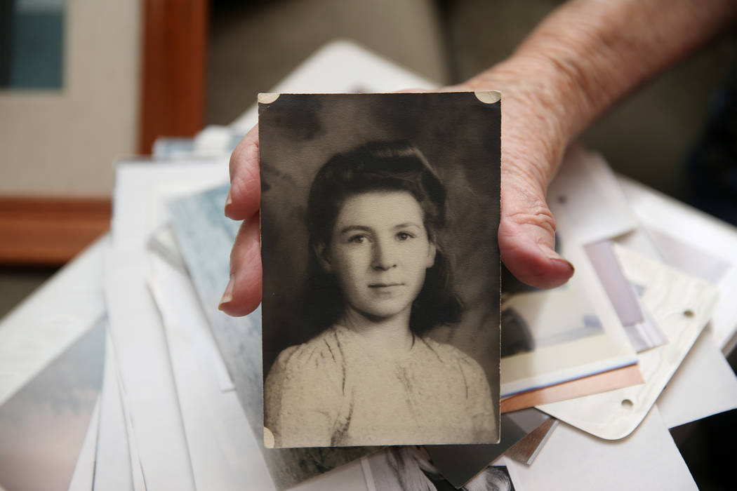 Etta Baykara, 91, shows a picture of herself in the eight grade at her home in Las Vegas, Wedne ...