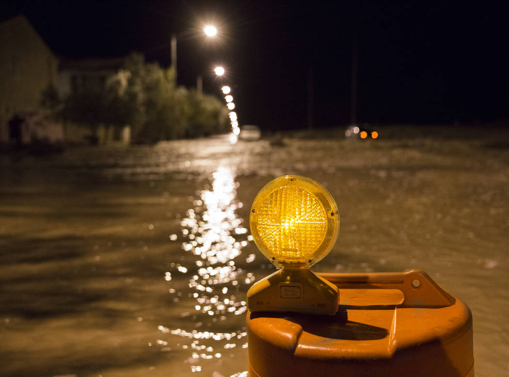 Nearly three feet of flood water fills the intersection of West Fitzwilliam Avenue near South F ...