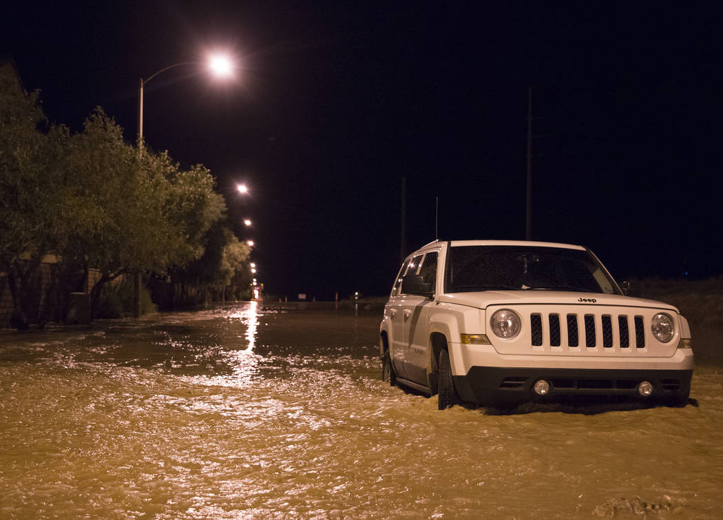 A vehicle is stuck in flood waters at the intersection of West Fitzwilliam Avenue and South For ...