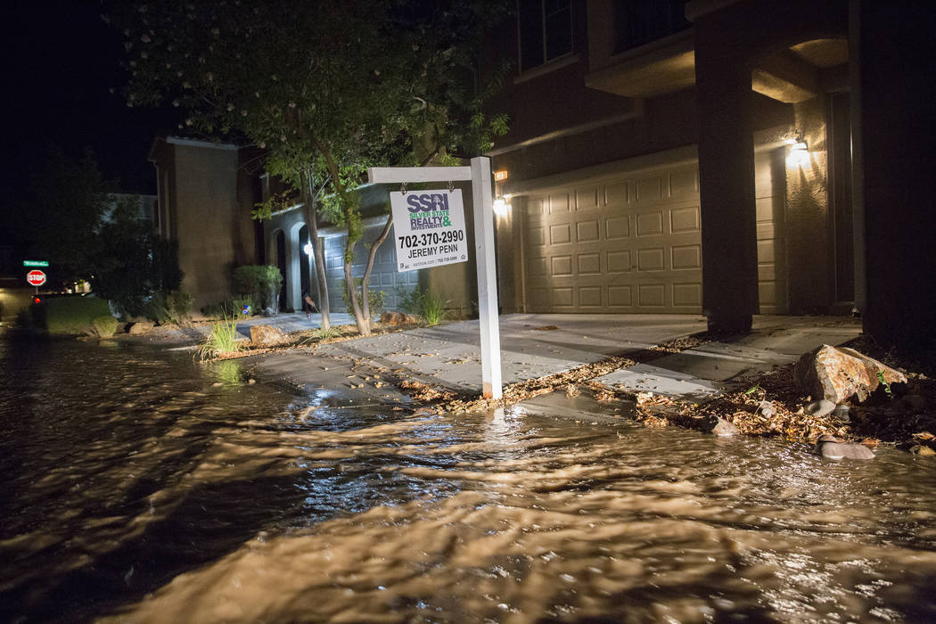 Southwest valley streets are flooded early Thursday morning, August 1, 2019, in Las Vegas. (Ben ...