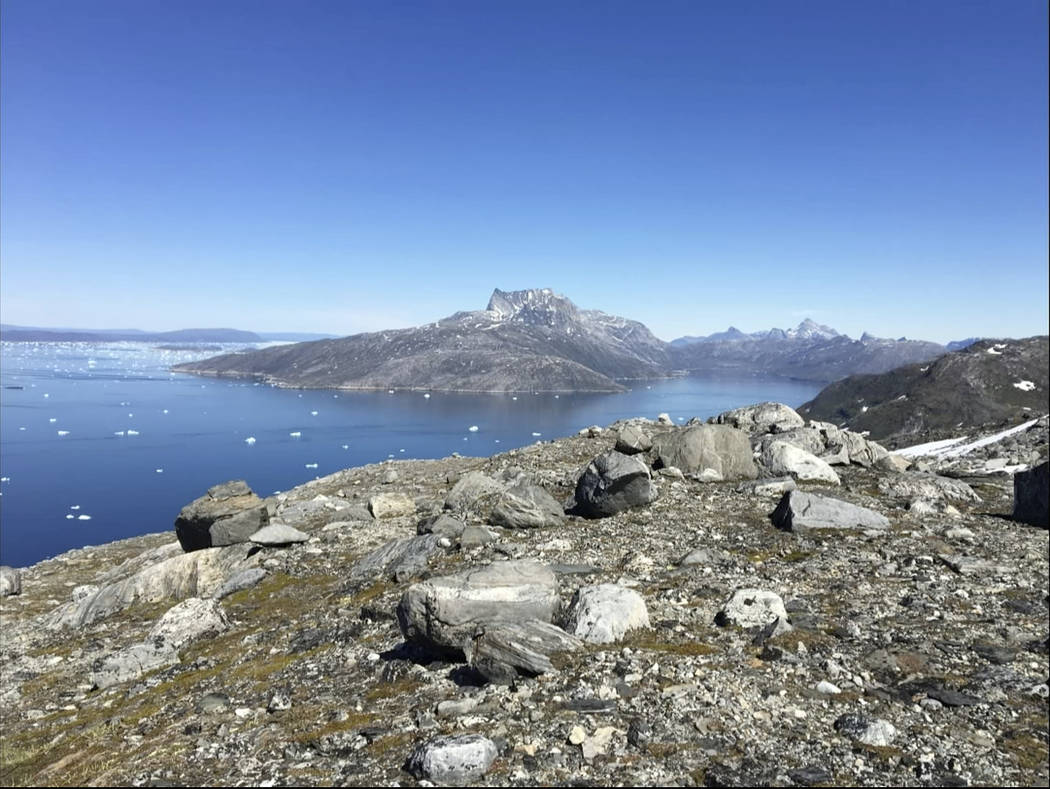 In this image taken on June 15, 2019 small pieces of ice float in the water in Nuuk Fjord, Gree ...