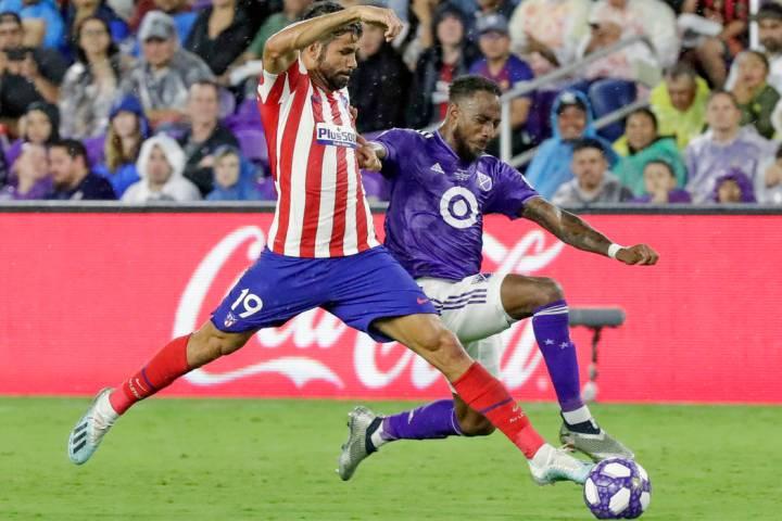 Atletico Madrid forward Diego Costa (19) pushes the ball past Minnesota United defender Romain ...
