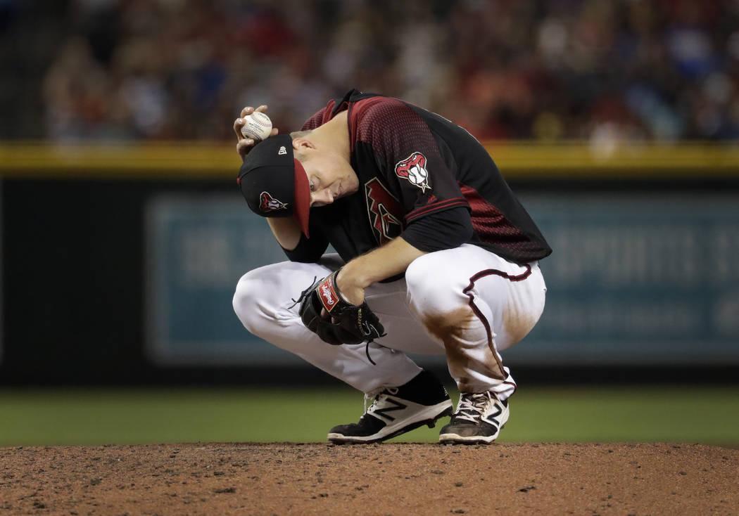 Arizona Diamondbacks starting pitcher Zack Greinke waits to face a hitter during the seventh in ...