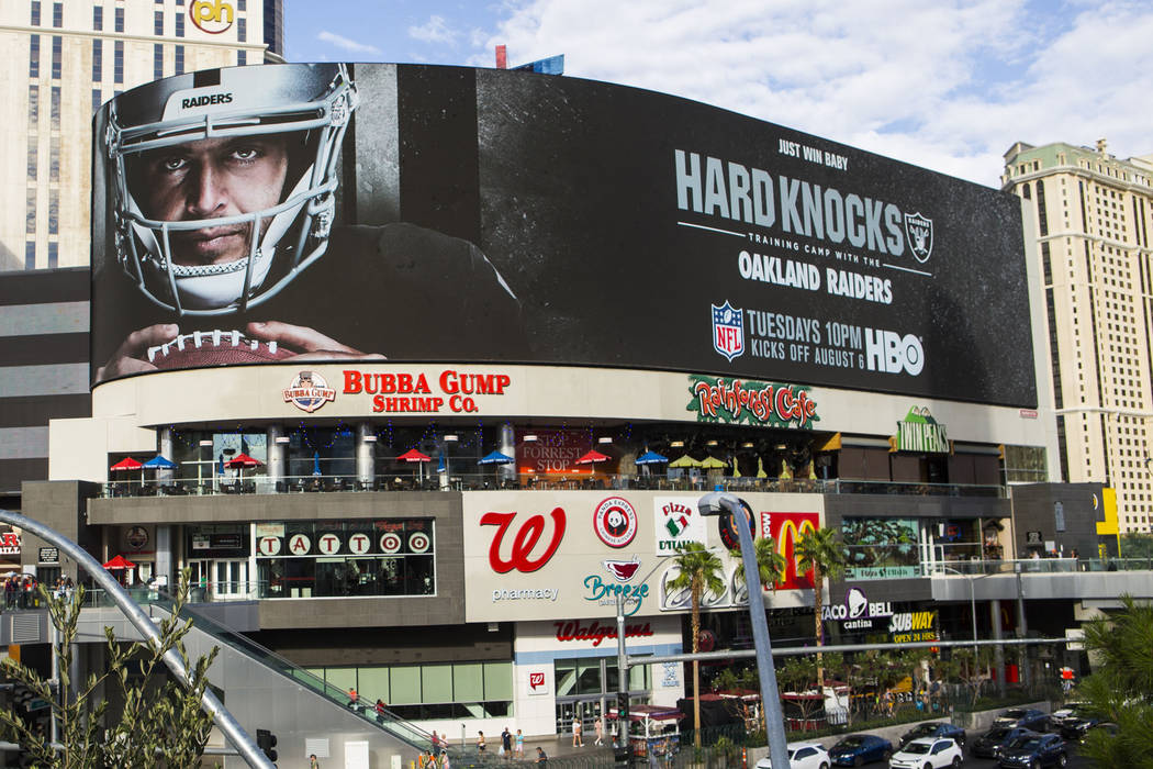 A digital billboard displays Oakland Raiders' Derek Carr in an advertisement for the upcoming s ...